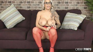 Big-boobed blonde in red stockings