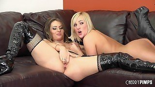 Two babes with sex toys are fucking