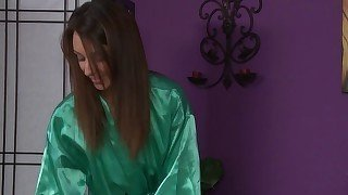 Green get-up brunette jerks off her