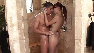 Oiled-up redhead rubbing her body