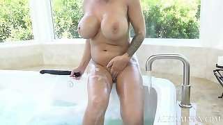 Big-boobed mother strokes her